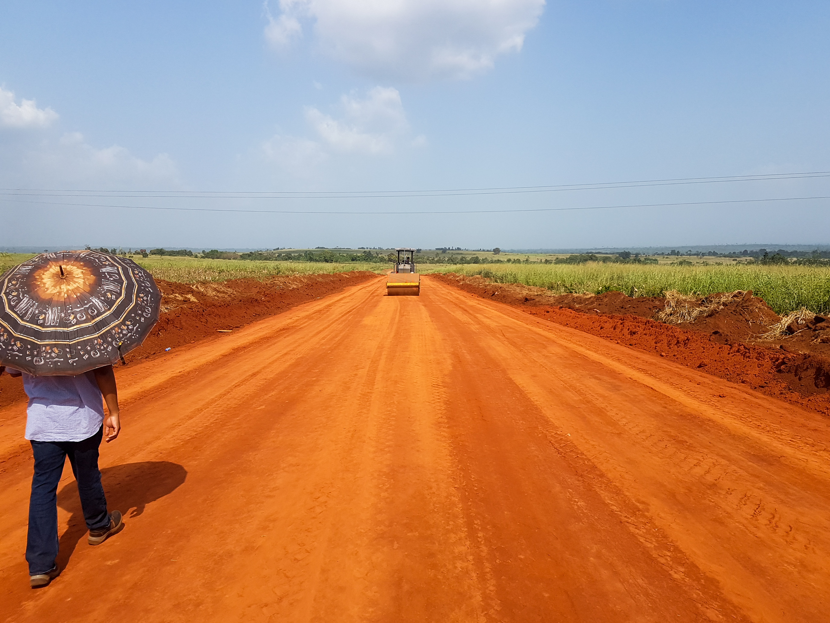 A local walks down a newly-constructed earthzyme® road in Sobe, Edo State, Nigeria