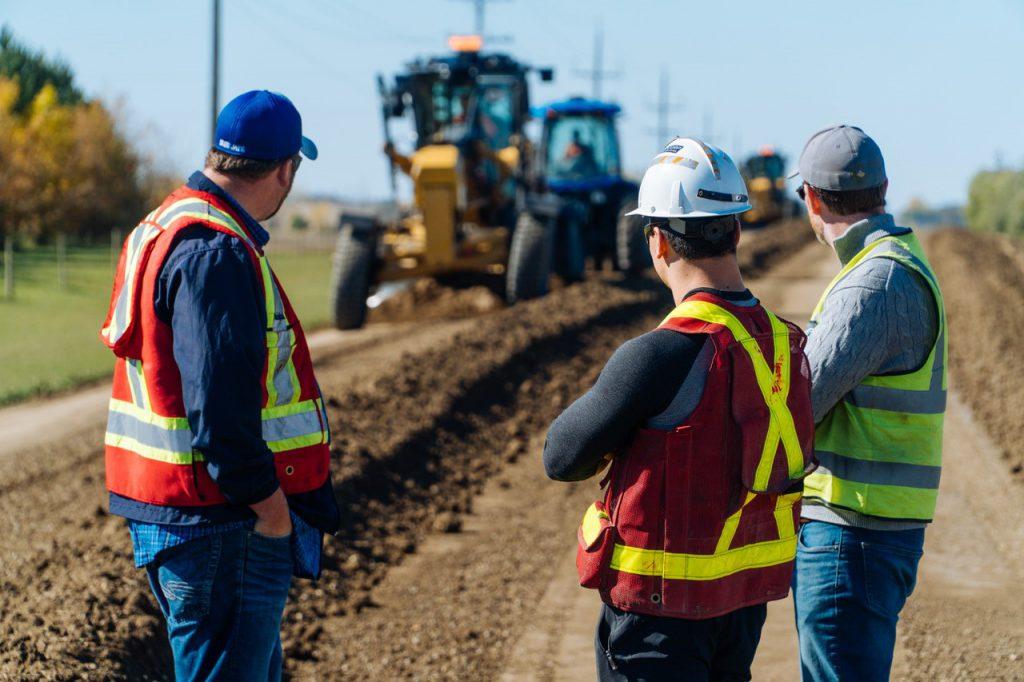 Riley Cram observes EarthZyme application at Curry's Landing near Cornwallis, Manitoba.